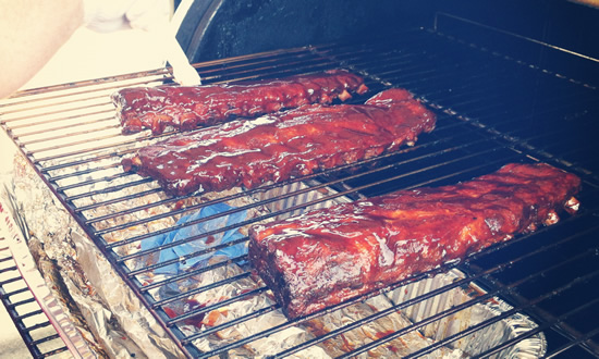 ribs with sauce on smoker - wet ribs